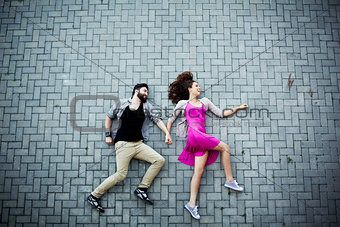 Couple on pavement