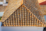 The roof with tiles in a sunny day