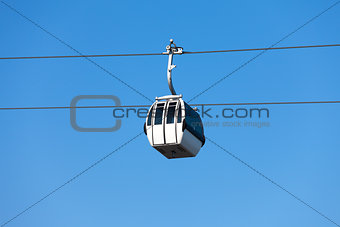 Cable car on blue sky background