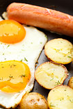 Breakfast with eggs, sausage and potato