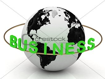 Business inscription in green letters and gold ring