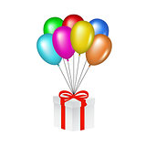 Multicolored glossy balloons lifting a gift box