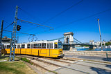 Yellow tram on the river bank of Danube in Budapest