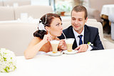 groom and bride drinking cappuccino