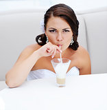 young bride drinking cappuccino