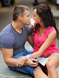 couple having fun with cotton candy floss