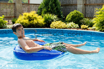 boy in the home swimming pool