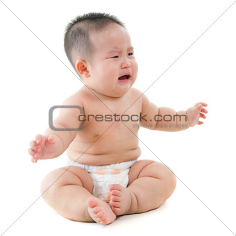 Crying Asian baby boy requests for food