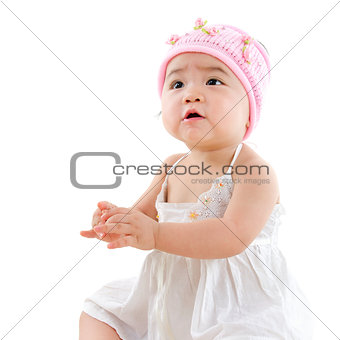 Asian baby girl looking up