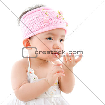 Asian baby girl eating