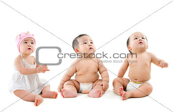 Group of Asian babies looking up