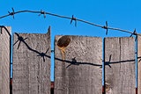 wooden fence of barbed wire
