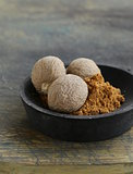 nutmeg whole and grated on a wooden table