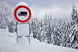 Stop traffic sign in the snowy forest