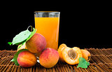 Glass apricot juice and fruits black isolated.