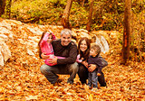 Cheerful family in autumn woods
