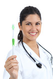 Beautiful female dentist doctor holding and showing a toothbrush