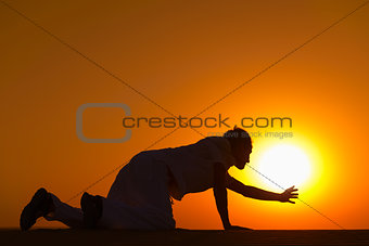 Tired and weaken man on all fours prays for help