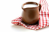 ceramic brown  jug full of milk, rustic style