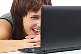 Beautiful woman laughing and watching a netbook computer