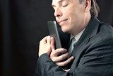 Businessman Cuddles Tablet