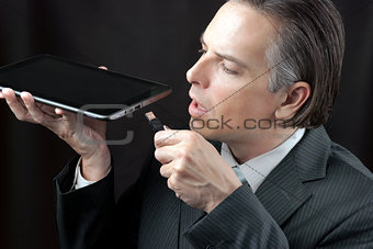 Businessman Plugs In Tablet