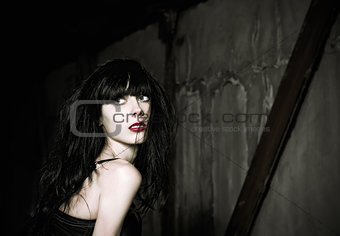 Portrait of beautiful goth girl looking back