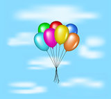 Multicolored balloons flying on blue sky