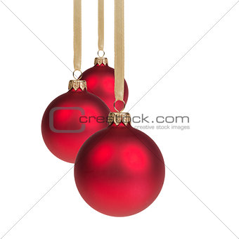 three red christmas balls hanging on ribbon