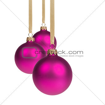 three purple christmas balls hanging on ribbon