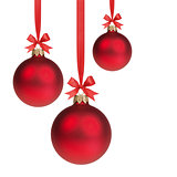 three red christmas balls hanging on ribbon with bows