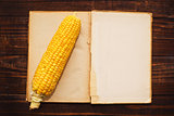 Ear of corn and open book