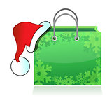shopping bag with Santa's hat isolated on white background. Conc