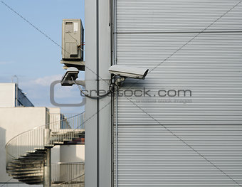 A CCTV camera at the corner of the building