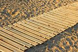 Wooden mat on a sandy beach