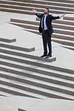 Businessman Business Man Arms Outstretched on Steps