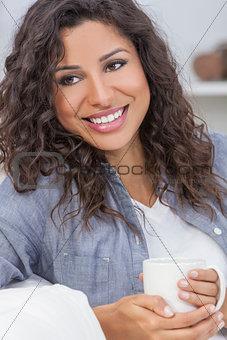 Beautiful Woman Smiling Drinking Tea or Coffee