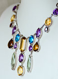 Necklace with colored precious jewel