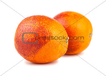 Pair of whole blood red oranges