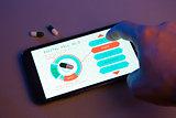 Hand choosing pill type on high-tech device, futuristic medicine