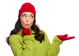Mixed Race Woman Wearing Hat and Gloves Gesturing to Side