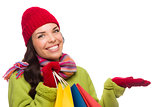 Mixed Race Woman Holding Shopping Bags Gesturing to Side