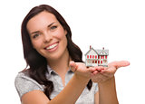 Happy Mixed Race Woman Holding Small House Isolated on White
