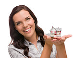 Smiling Mixed Race Woman Holding Small House Isolated on White
