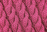 Closeup of pink cable stitch knitting