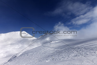 Off-piste slope with traces of skis