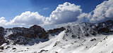 Panorama of snowy mountains in sun day