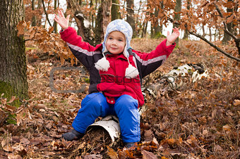 Boy in autumn forest