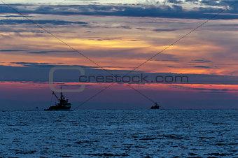 Fishing boats and sunset