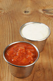 Tin cups of salsa and ranch dressing